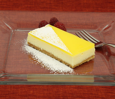 Lemon-Glazed Cheesecake Bars made with Golden OREO Pieces Recipe