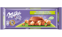 MILKA NOISETTES ENTIERES <br>EXTRA GOURMAND
