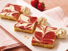 Strawberry Swirl Cheesecake Bars made with Golden OREO Cookies Recipe